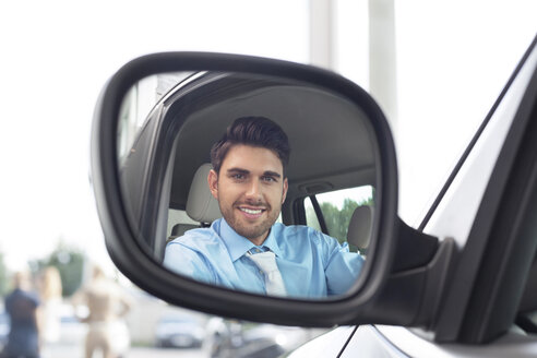 At the car dealer, Reflection of man in wing mirror - MLF000107