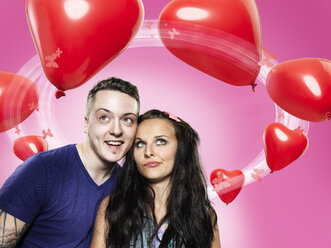 Couple looking at heart-shaped balloons, Composite - STKF000349