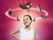 Smiling young woman looking at flying shoes, Composite - STKF000340