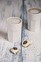 Cups of latte macchiatto with almond biscuits on wooden board - SBDF000180