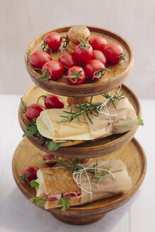 Baguette sandwiches on etagere with tomatoes - ECF000339