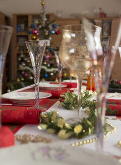 Dining table with glasses, dishes, napkins  and christmas decoration - MAB000159
