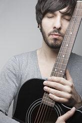 Portrait of a young Man holding a guitar - DSC000111