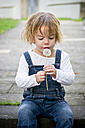 Little girl looking at the dandelion in her hands - LVF000204