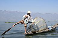 Myanmar, Lake Inle, Fisherman standing on boat on one leg - DR000171