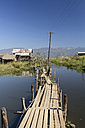 Myanmar, View of fishing village and wooden path at Lake Inle - DRF000178