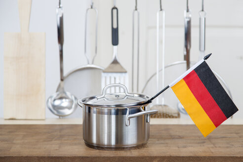A cooking pot with a german flag in the kitchen - DRF000153