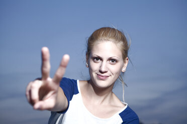 Young woman showing victory sign - FEXF000011
