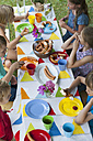 Children sitting at table on a birthday party - NHF001424