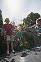Children bouncing on trampoline - NHF001467