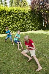 Boys playing tug-of-war on a birthday party - NHF001455