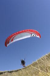 France, Bretagne, Landeda, Man paragliding - LAF000158