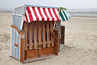 Germany, Lower Saxony, Eastern Friesland, Dangast, closed roofed wicker beach chairs - WI000029