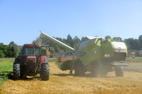 Germany, Upper Bavaria, Combine harvester in field of wheat - LB000263