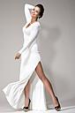 Woman wearing white gown, studio shot - MAE007267