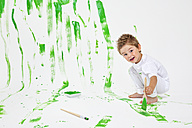 Toddler having fun with green paint - MVC000038