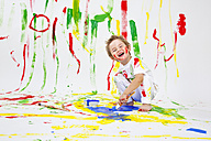 Toddler having fun with green paint - MVC000032