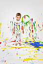 Toddler having fun with green paint - MVC000035