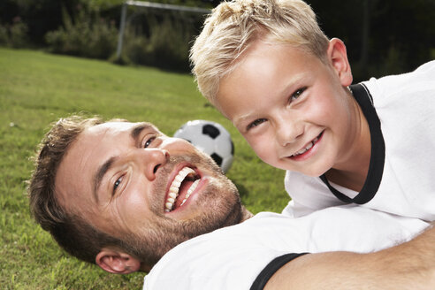 Germany, Cologne, Father and son playing soccer - PDF000400