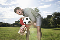 Germany, Cologne, Father and son playing soccer - PDF000403