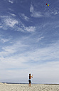 Germany, Lower Saxony, East Frisia, Langeoog, boy flying a kite - JAT000301