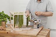 Man preparing green tagliatelle - ECF000349