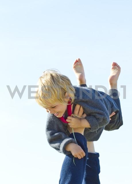 Denmark, Ringkoebing, father lifting up his daughter - JFEF000225