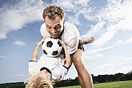 Gernany, Cologne, Father and son playing football - PDF000446