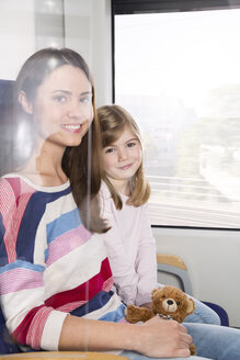 Mother and daughter in a train - KFF000265