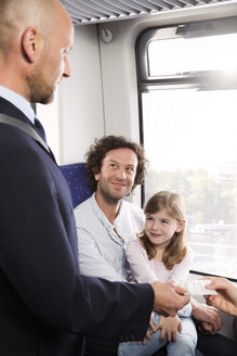 Conductor and family in a train - KFF000282