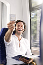 Man showing ticket in a train - KFF000279