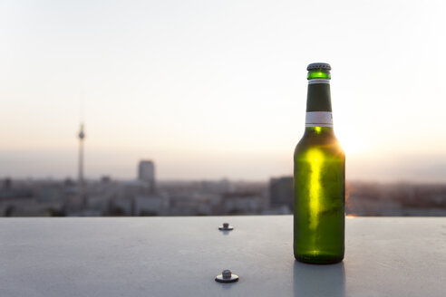 Germany, Berlin, Bottle of beer on balustrade - FKF000260