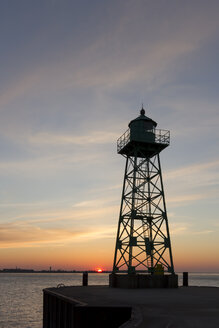 Germany, Bremen, Bremerhaven lighthouse at sunset - SJF000061