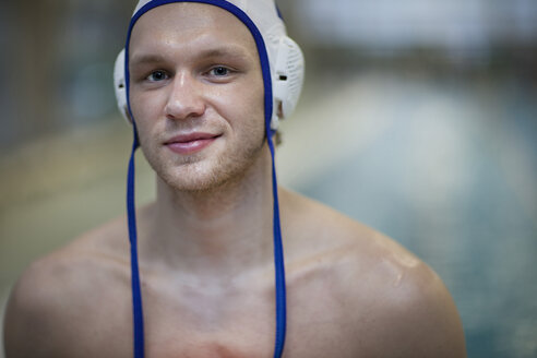 Smiling water polo player outside pool, portrait - SEF000068