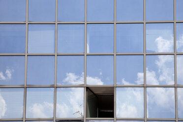 Germany, North Rhine Westphalia, glass facade with open window - WIF000100