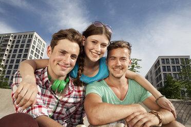 Germany, Bavaria, Munich, Three friends hugging - RBF001345