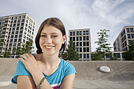 Germany, Bavaria, Munich, Smiling young woman outdoors - RBF001321