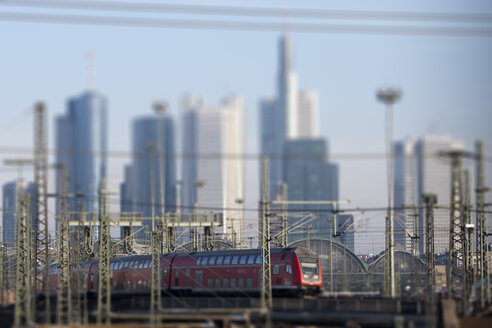 Germany, Hesse, Frankfurt, Train at central station with financial district in background - AM000921