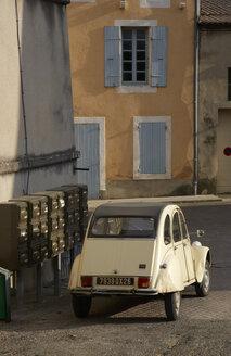 France, Drome, Suze-la-Rousse, Citroen 2CV in a typical french village - DHL000077