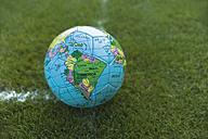 Soccer ball on football ground - TCF003584