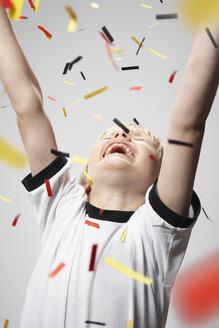 Boy in soccer jersey cheering - PDF000475