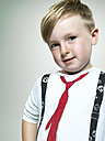 Portrait of smiling little boy, studio shot - STKF000367