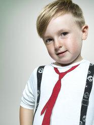 Portrait of smiling little boy, studio shot - STKF000367
