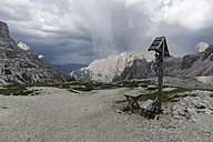 Italy, Dolomites, Tre Cime di Lavaredo, bench at wayside cross - PAF000033