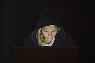 Young woman using laptop by night - BFRF000306