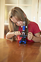 Germany, Baden-Wuerttemberg, Freiburg, ittle girl with microscope - DHL000101