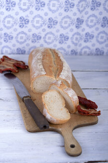 Ciabatta bread with dreid tomatoes on wooden table - ODF000560