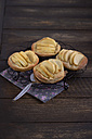 Apple tartlets on wooden table - ODF000576