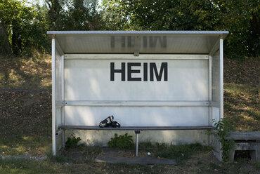 Germany, Bavaria, Munich, football shoes lying  on coaching bench - ASF005199