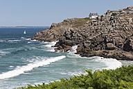 France, Bretagne, Douarnenez, House at rocky coast - LAF000209